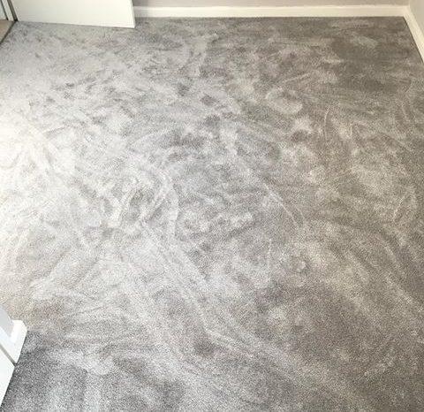 Grey carpet installation. All The Floors.