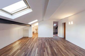 Wooden flooring installed in a loft.