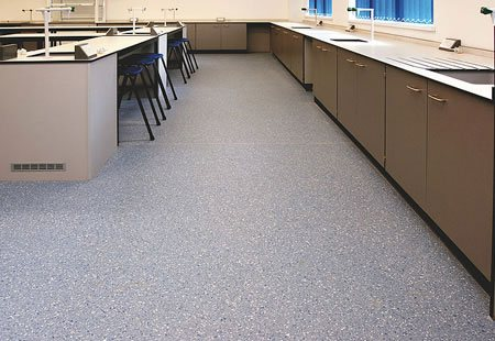 Commercial safety flooring installation.
